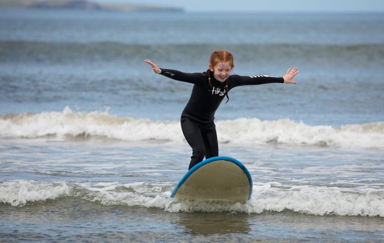 girl surfing on blue surfboard