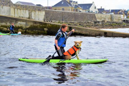woman supping with her dog in enniscrone